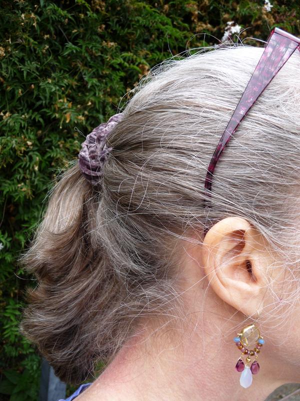 Earrings-and-gray-haired-with-ponytail