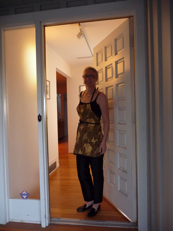 Answering-The-Door-In-Cooking-Apron
