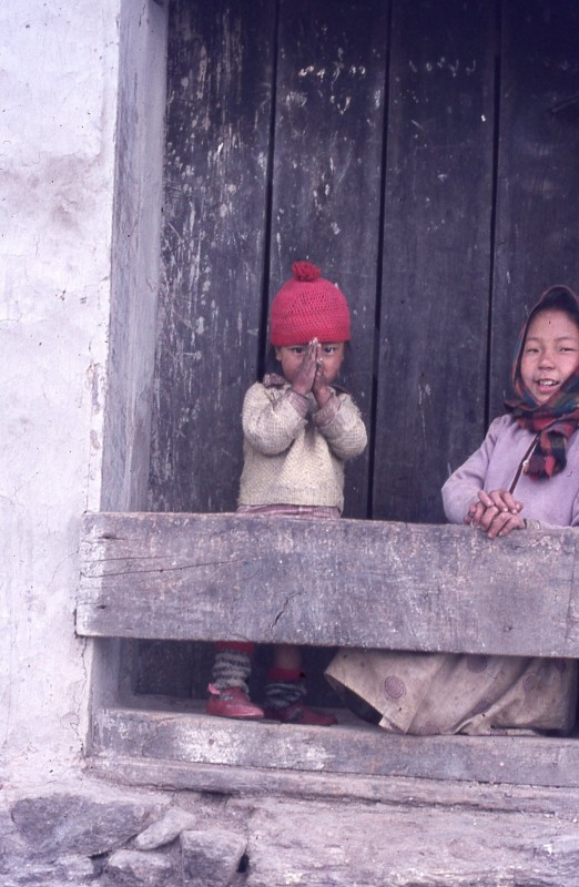 A Small Child Saying Namaste In The Hills Above Darjeeling