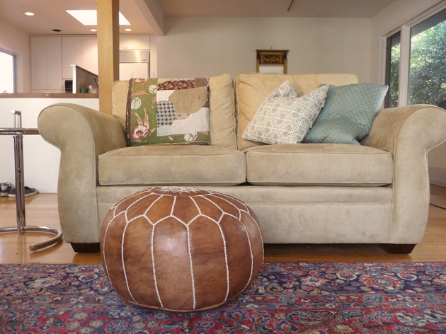 Pottery-Barn-Pearce-Loveseat-with-Moroccan-Pouf-and-Eileen-Gray-style-Table