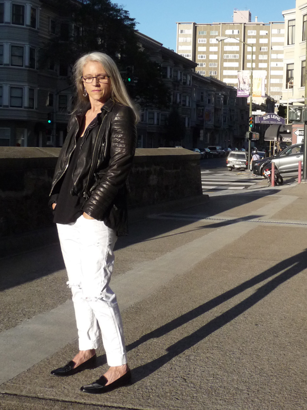 Middle-Aged-Lady-In-Biker-Jacket-And-Distressed-White-Jeans-After-Labor-Day