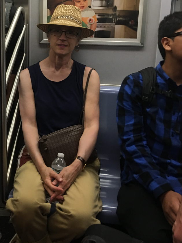 riding-the-subway-in-a-hat