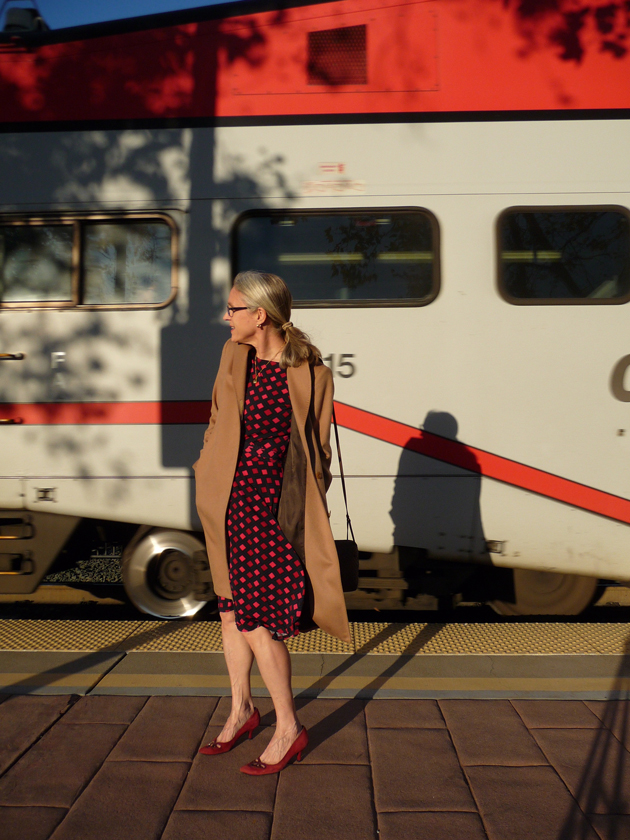 the-express-train-passes-in-leota-dress-and-maxmara-camel-coat